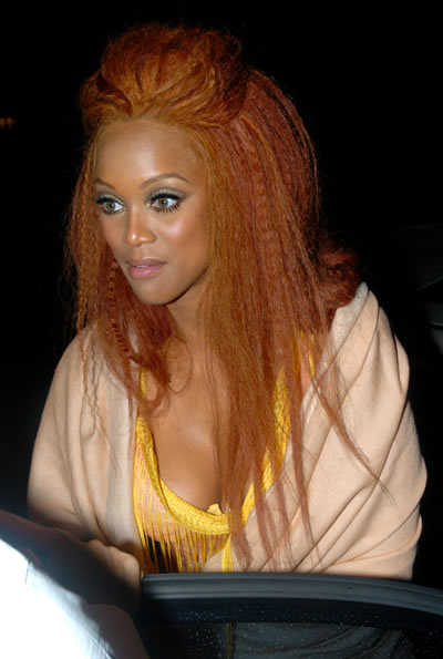 tyra-banks-frizzy-orange-hairstyle